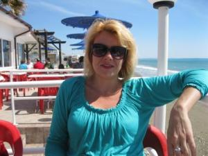 Abi enjoying lunch by the sea in Limassol